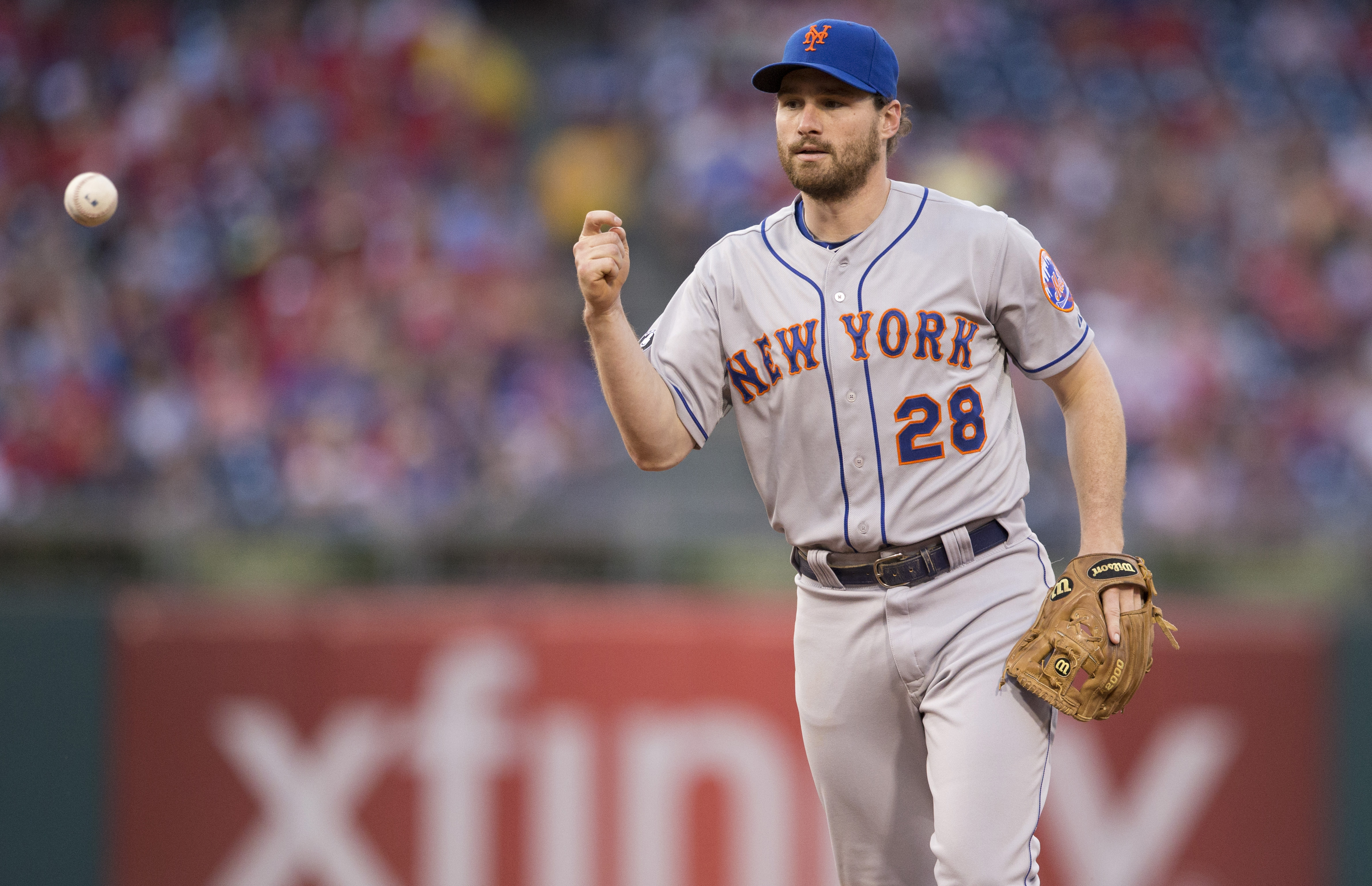 PHILADELPHIA, PA - AUGUST 8: Second baseman Daniel Murphy #28 of the New York Mets flips the ball to first base to complete a double play in the bottom of the second inning against the Philadelphia Phillies on August 8, 2014 at Citizens Bank Park in Philadelphia, Pennsylvania. (Photo by Mitchell Leff/Getty Images)