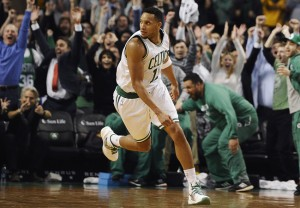 Boston Celtics' Evan Turner watches his game-winning basket go in with .2 seconds left on the clock during the second half of an NBA basketball game against the Atlanta Hawks, Wednesday, Feb. 11, 2015, in Boston. The Celtics won 89-88. (AP Photo/Jessica Hill)