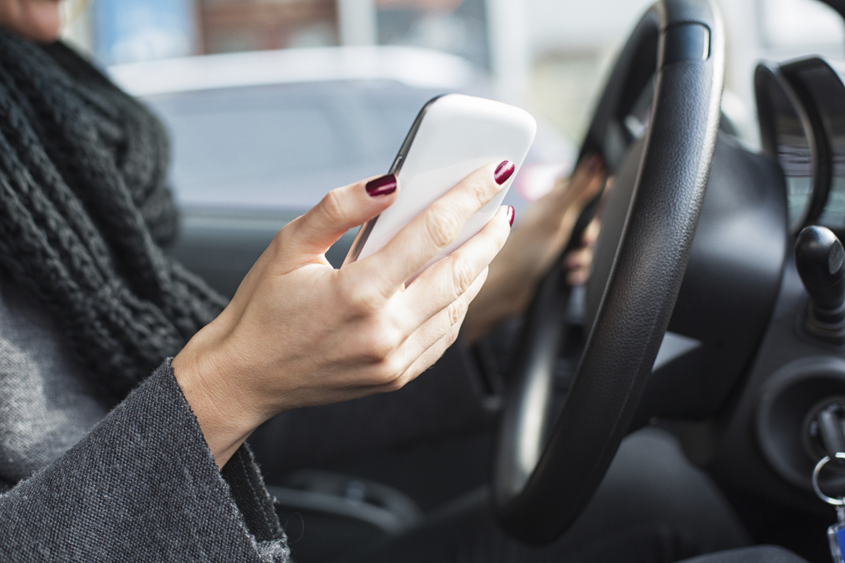 Reckless driving: woman texting in the car.