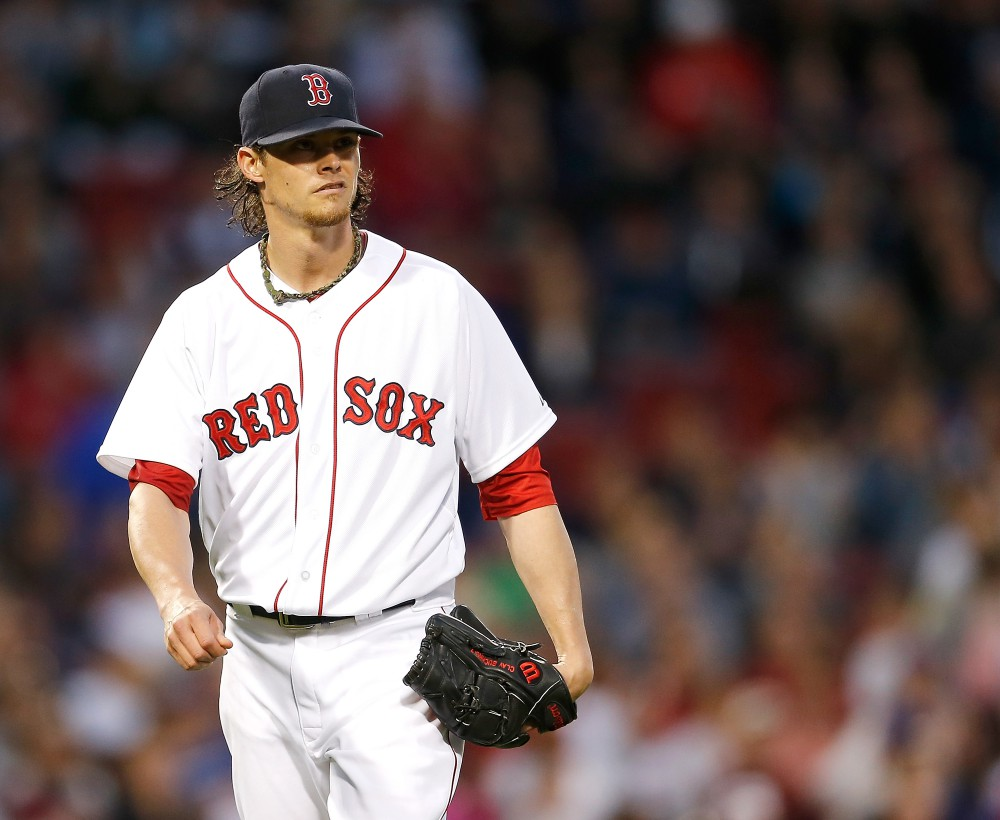 BOSTON, MA - MAY 21:  Clay Buchholz #11 of the Boston Red Sox reacts in the fourth inning during a game with the Toronto Blue Jays at Fenway Park on May 21, 2014 in Boston, Massachusetts.  (Photo by Jim Rogash/Getty Images)