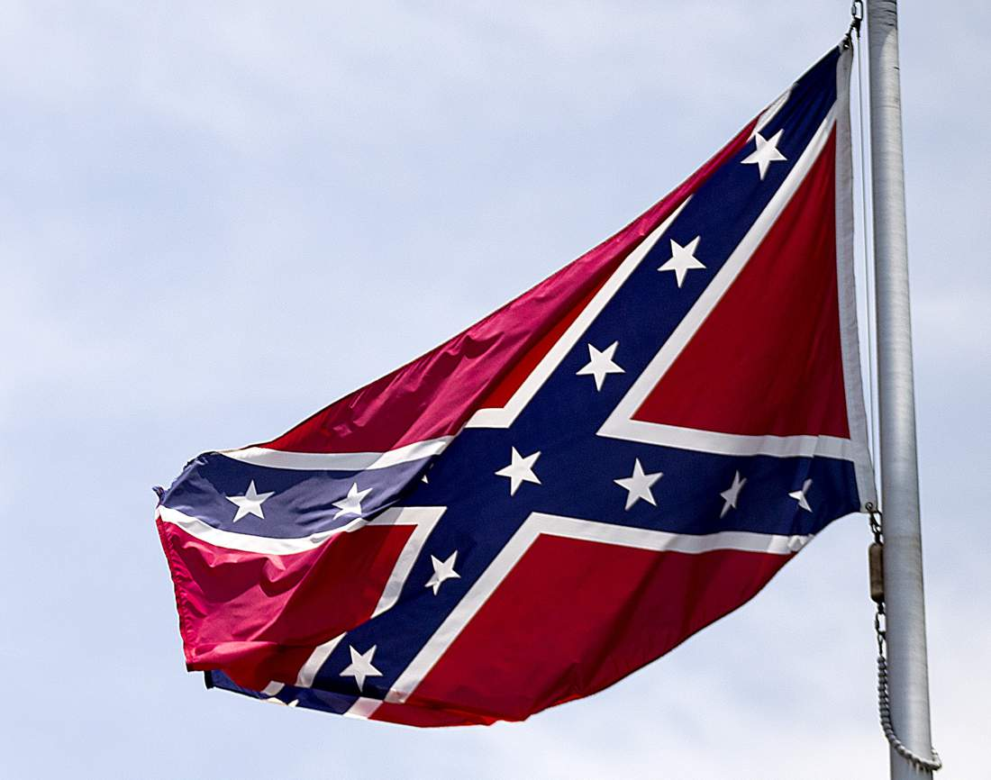 FILE - In this June 30, 2015 file photo, a Confederate flag flies at the base of Stone Mountain in Stone Mountain, Ga.  The House is about to put its members on record on whether Confederate flags can decorate rebel graves in historic federal cemeteries and if their sale should be banned in national park gift shops.  The vote comes after southern lawmakers complained that they were sandbagged two nights ago when the House voted — without a recorded tally — to ban the display of Confederate flags at historic federal cemeteries and strengthen Park Service policy against its sale in gift shops.  (AP Photo/David Goldman, File)