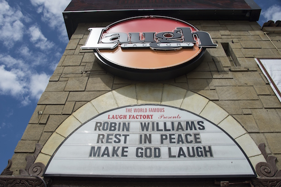 A marquee message at the Laugh Factory comedy club Hollywood pays tribute to the late Robin Williams, August 12, 2014, in Hollywood, California. Academy Award-winning actor and comedian Robin Williams was found dead in his Marin County home August 11 of an apparent suicide. He was 63 years old. AFP PHOTO / Robyn Beck        (Photo credit should read ROBYN BECK/AFP/Getty Images)