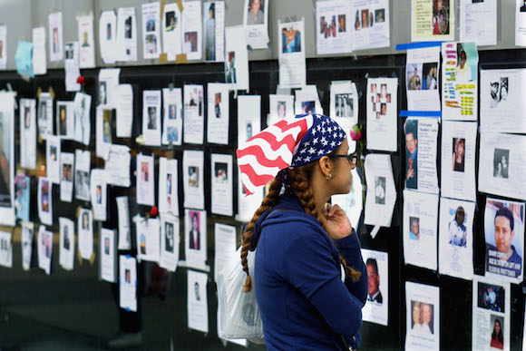 NEW YORK - SEPTEMBER 17: A woman looks at flyers posted at the University Medical Center on 1st Avenue seeking information on loved ones after the World Trade Center attacks September 17, 2001 in New York City. (Photo by Thomas Nilsson/ Getty Images)