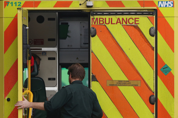 LONDON, UNITED KINGDOM - JANUARY 06: A medic opens an ambulance door outside the Accident and Emergency ward at St Thomas' Hospital on January 6, 2015 in London, United Kingdom. Figures released suggest that the NHS in England has missed its four-hour A&E waiting time target with performance dropping to its lowest level for a decade. (Photo by Dan Kitwood/Getty Images)