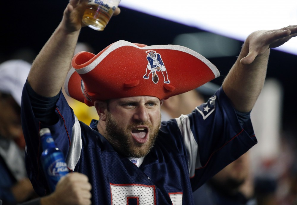 A New England Patriots fan cheers in the second half of an NFL football game between the Patriots and Miami Dolphins, Thursday, Oct. 29, 2015, in Foxborough, Mass. (AP Photo/Michael Dwyer)