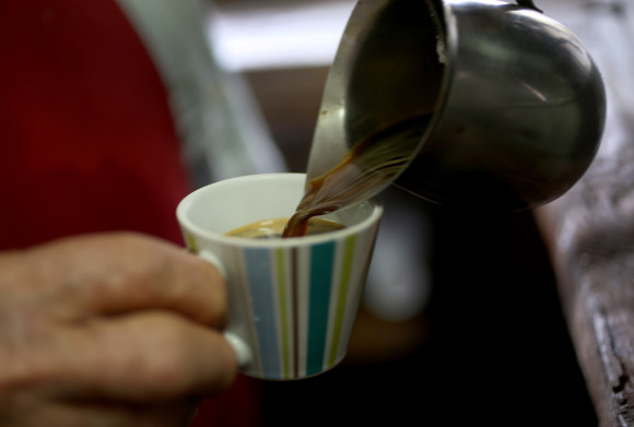 MIAMI, FL - MARCH 10: An expresso coffee is prepared for a customer at the Los Pinarenos Fruteria on March 10, 2015 in Miami, Florida. A panel of government-appointed scientists at the Dietary Guidelines Advisory Committee charged with proposing changes to U.S. dietary guidelines announced recently that three to five cups of coffee daily do not have long-term health risks, and help reduce the risk for heart disease and type 2 diabetes. (Photo by Joe Raedle/Getty Images)