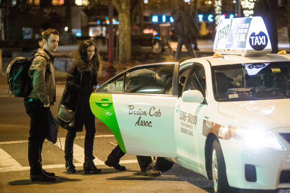 11/08/2013 BOSTON, MA A small group crowded into a cab outside Faneuil Hall (cq) in Boston at 1:20AM. (Aram Boghosian for The Boston Globe)