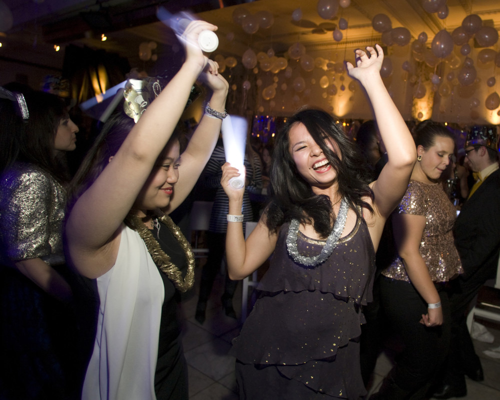 Mai Bui of Boston, left, and Hong Le of San Francisco tear up the dance floor at 52 Temple. Monday, December 31, 2012, at 52 Temple New Years Eve in Paris event. Photo by Laurie Swope
