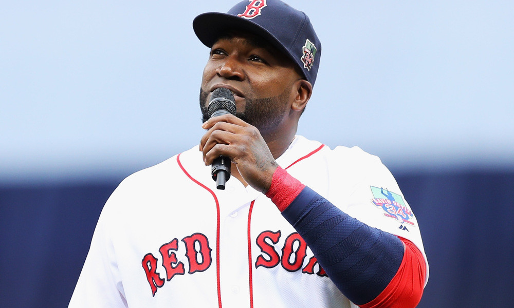 BOSTON, MA - OCTOBER 02:  David Ortiz #34 of the Boston Red Sox addresses the crowd during the pregame ceremony to honor his retirement before his last regular season home game at Fenway Park on October 2, 2016 in Boston, Massachusetts.  (Photo by Maddie Meyer/Getty Images) ORG XMIT: 607686033 ORIG FILE ID: 612049674