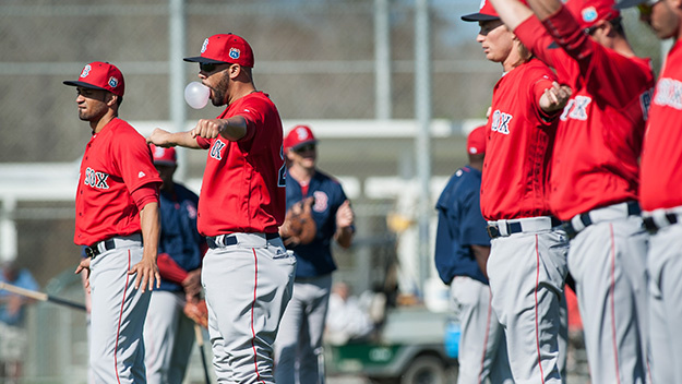 FT. MYERS, FL - FEBRUARY 19: David Price of the Boston Red Sox runs stretches while blowing a bubble at a spring training workout at Fenway South on February 19, 2016 in Ft. Myers, Florida. (Photo by Cliff McBride/Getty Images)