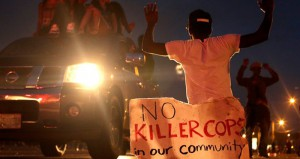 08.18.14news-ap-ferguson-killer-cops-edit