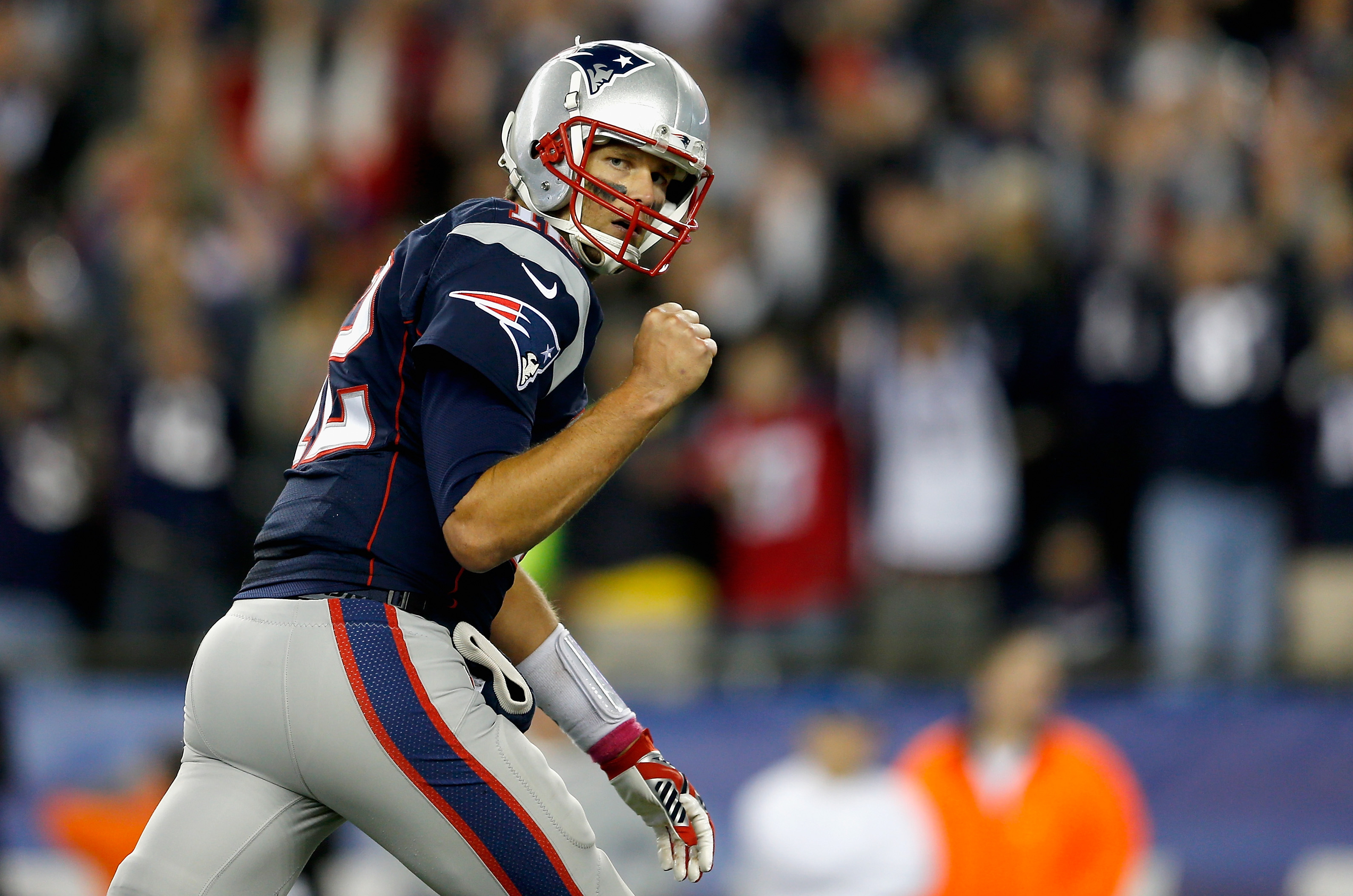 FOXBORO, MA - OCTOBER 05:  Tom Brady #12 of the New England Patriots reacts after throwing a touchdown pass during the third quarter against the Cincinnati Bengals at Gillette Stadium on October 5, 2014 in Foxboro, Massachusetts.  (Photo by Jim Rogash/Getty Images)