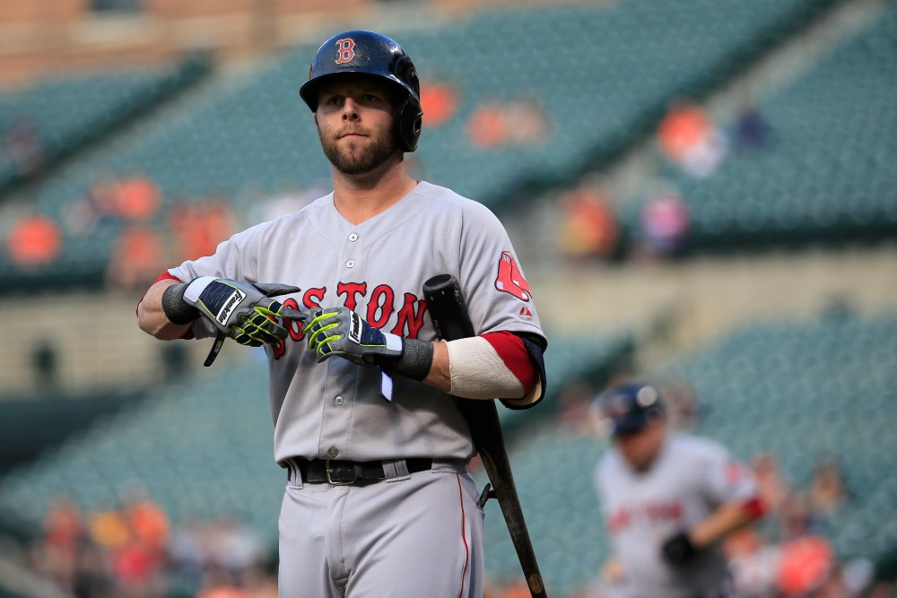 BALTIMORE, MD - JUNE 09: Dustin Pedroia #15 of the Boston Red Sox reacts after striking out for the third out of the first inning against the Baltimore Orioles at Oriole Park at Camden Yards on June 9, 2014 in Baltimore, Maryland.  (Photo by Rob Carr/Getty Images)
