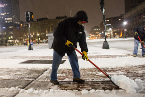 Boston, MA - 12/29/2015  - Oscar Velasquez removes snow along Boylston in Boston, MA, December 29, 2015. Keith Bedford/Globe Staff)