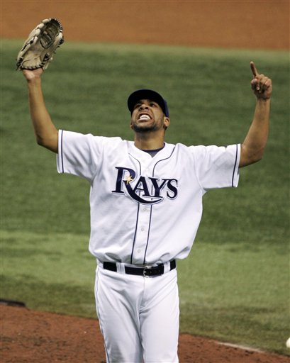 Tampa Bay Rays pitcher David Price reacts after defeating the Boston Red Sox 3-1 to win the American League baseball championship series in Game 7 in St. Petersburg, Fla., Sunday, Oct. 19, 2008. (AP Photo/Darron Cummings)
