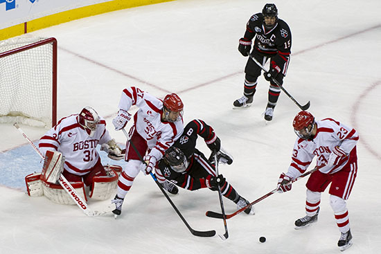 2/1/16 -- Boston, Massachusetts  BU Terriers from right Jakob Forsbacka Karlsson (CAS'19), Doyle Somerby (COM'17) and goalie Sean Maguire (CAS'16) swarm around an off balance Adam Gaudette of Northeastern during the Beanpot Semifinal at the TD Garden on February 1, 2016.  Photo by Andy Costello for Boston University Photography