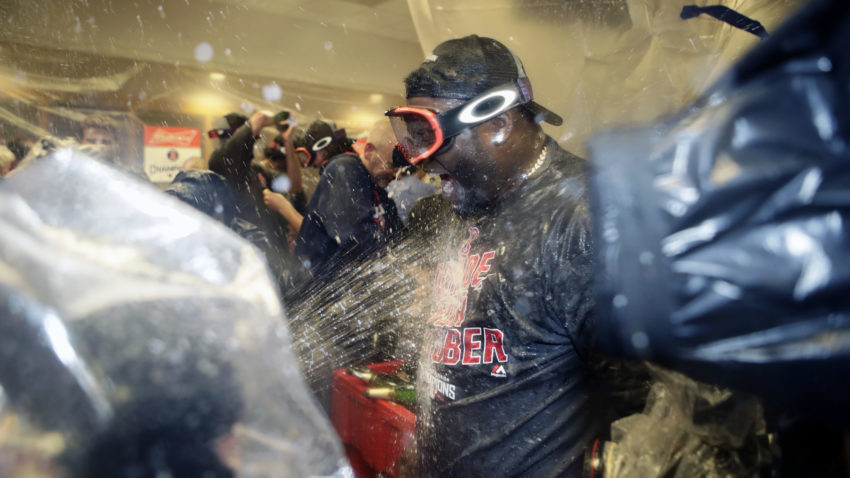 Boston Red Sox's David Ortiz celebrates with teammates after clinching the American League Eastern Division after a baseball game against the New York Yankees Wednesday, Sept. 28, 2016, in New York. (AP Photo/Frank Franklin II)