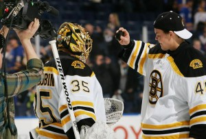 2013-03-31-bruins-at-sabres-tuukka-rask-gives-the-game-puck-to-anton-khudobin-for-his-2-0-shutout