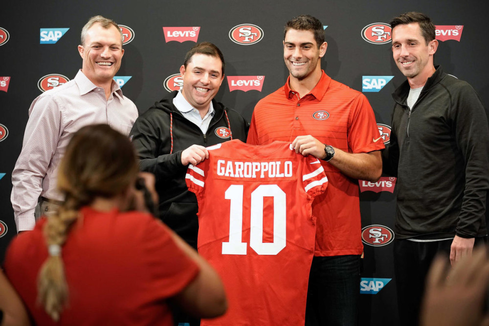 Oct 31, 2017; Santa Clara, CA, USA; San Francisco 49ers general manager John Lynch (far left) and owner Jed York (left)  and quarterback Jimmy Garoppolo (right) and head coach Kyle Shanahan (far rright) pose for a photo after a press conference at Levi's Stadium. Mandatory Credit: Stan Szeto-USA TODAY Sports
