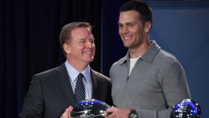 Feb 6, 2017; Houston, TX, USA; NFL commissioner Roger Goodell (L) presents New England Patriots quarterback Tom Brady (R) with the Pete Rozelle Trophy as Super Bowl LI most valuable player at the George R. Brown Convention Center. Mandatory Credit: Kirby Lee-USA TODAY Sports